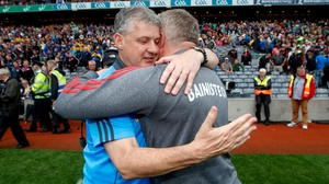 Kevin McStay (L) and Stephen Rochford embrace at the final whistle
