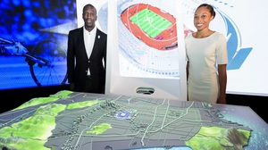 Michael Johnson (L) and Allyson Felix pose next to a scale model of Los Angeles during the presentation of Los Angeles 2024 Olympic bid's showroom in Lausanne earlier this month