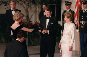 Ronald Reagan and his wife Nancy welcome Princess Diana to the White House in 1985. Diana wore a midnight blue Victor Edelstein gown.