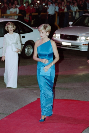 Beautiful in blue. Diana arrives at the Victor Chang Cardiac Research Institute dinner dance in Sydney in 1996.