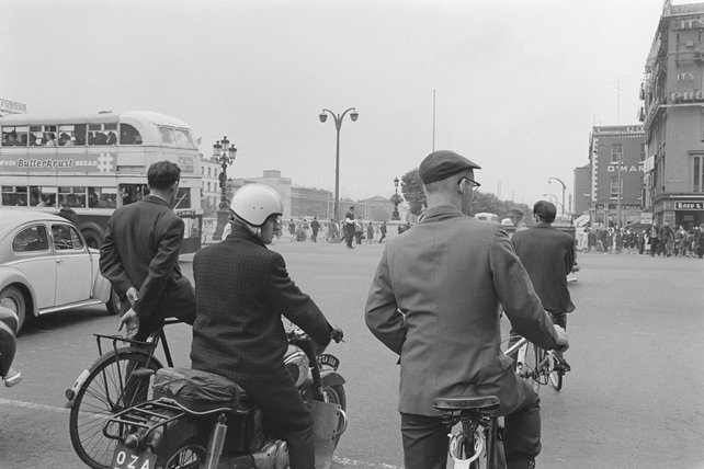 Cyclists at Eden Quay/O'Connell Street, Dublin city (1966)