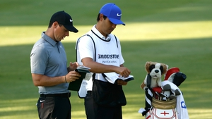McIlroy works though his yardages with best friend Harry Diamond