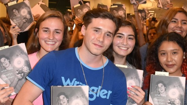 Brooklyn Beckham surrounded by fans this week at a signing for his new photography book 'What I See'