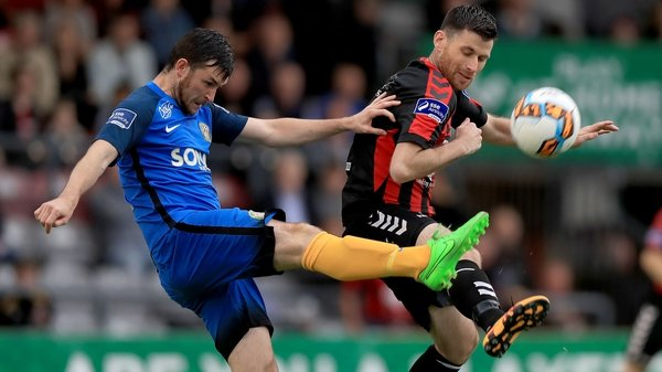 Dinny Corcoran and Ryan Brennan challenge for the ball