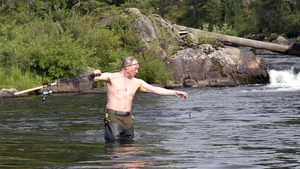 Russian President Vladimir Putin fishing in a mountain lake during his holiday in the Tyva Republic, southern Siberia