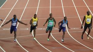 Justin Gatlin (left) stunned Usain Bolt in his final race