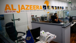 Employees of Qatar-based news network and TV channel Al-Jazeera are seen at their Jerusalem office in July