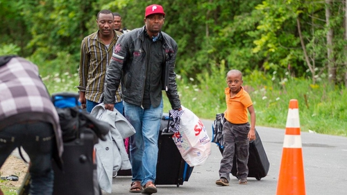 Asylum seekers arrive at the US border with Canada