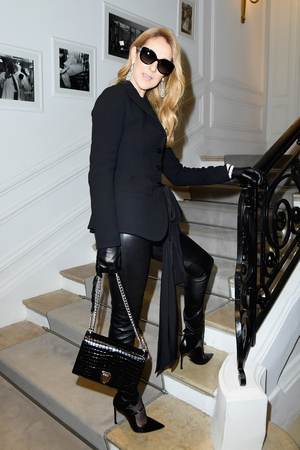 Every bit the fashion legend, Celine attended Christian Dior's Haute Couture 2016 show wearing all black. Fierce.