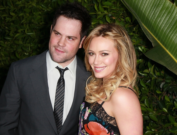Professional hockey player Mike Comrie (L) and wife actress Hilary Duff attend An Evening of 'Southern Style' presented by the St. Bernard Project & the Spears family at a private residence on May 11, 2011