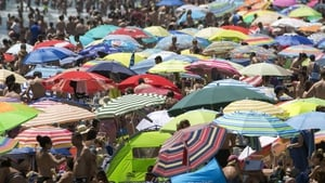The umbrellas are up all over Spain. Photo: Kai Foersterling/EPA