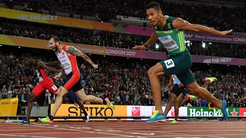 Turkey's Ramil Guliyev (C) crosses the finish-line ahead of South Africa's Wayde Van Niekerk (R) and Trinidad and Tobago's Jereem Richards (L) in the final of the men's 200m