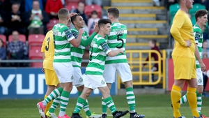 Graham Burke celebrates with his Rovers team-mates as the Hoops beat Glenville