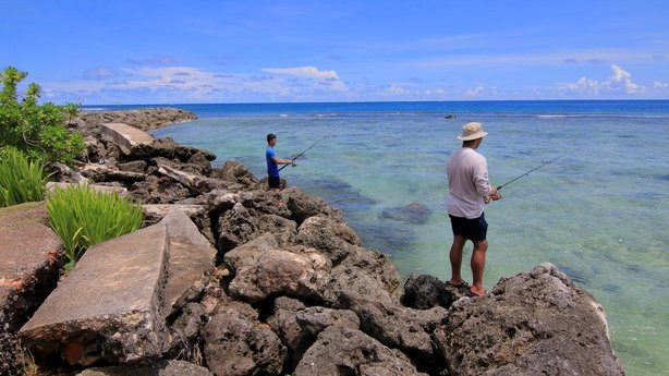 Residents go fishing on the island of Guam