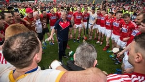 Cork manager Kieran Kingston speaks to his players after winning the Munster title