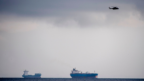 A helicopter flies over the sea off  Copenhagen Harbour during the search yesterday