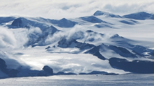 Mountains stand near the coast of West Antarctica