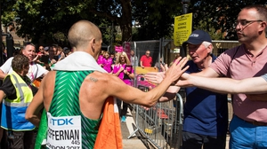Rob Heffernan goes to his supporters after crossing the line in London
