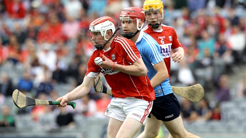 Dublin's Conor O'Callaghan pursues Eoghan O'Neill of Cork.