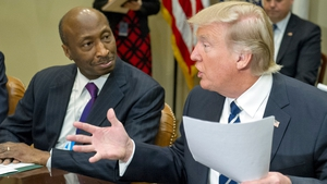 Kenneth Frazier pictured alongside Donald Trump at the White House in January