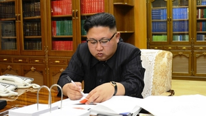 North Korea's leader is reported to have received plans for launching missile strikes near the US Pacific territory of Guam