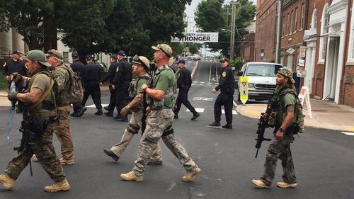 Armed citizen militia on the march in Charlotttesville last Saturday. Photo: EPA/Virginia State Police