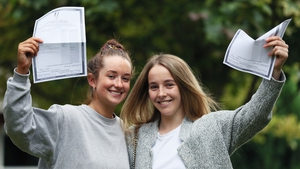 Ciara Curley (L) and Aoife Moore celebrate their results at Maryfield College, Drumcondra, Dublin