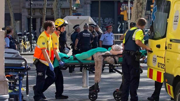 Spain hunts driver who killed 13 in Barcelona, says bomb plot foiled