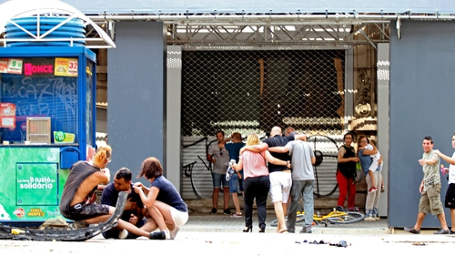 Injured people react after a van crashed into pedestrians in Las Ramblas