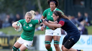 Ireland's Claire Molloy is tackled by Annaelle Deeshaye of France