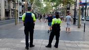 Police officers stand guard on the in Las Ramblas boulevard