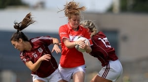 Cork's Roisin Phelan bursts past Deirdre Brennan and Megan Glynn of Galway