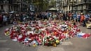 People gather around tributes on Las Ramblas today