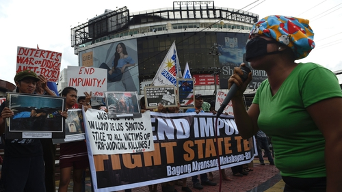 Relatives protest against extra judicial killings in the Philippines