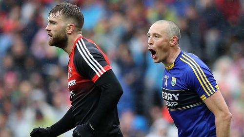 Kieran Donaghy (R) celebrates Kerry's goal in front of Aidan O'Shea
