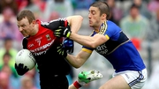 Mayo's Colm Boyle and Stephen O'Brien of Kerry scrap for possession