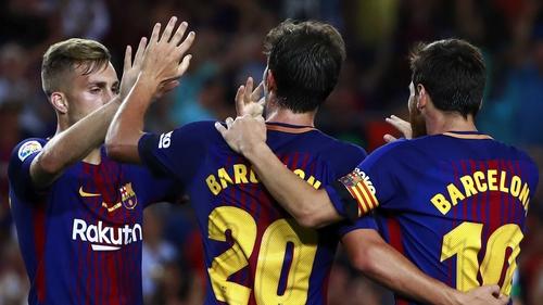Sergi Roberto (C) celebrates scoring Barca's second goal with Lionel Messi (R) and Gerard Deulofeu (L)