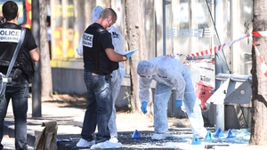 Police and forensic teams at the site of one of the incidents