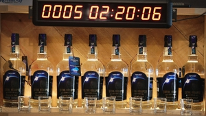 An countdown clock over a display of Total Eclipse Moonshine distilled to commemorate the eclipse, at Casey Jones Distillery in Hopkinsville, Kentucky