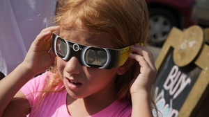 Zoe Spyridonos tries out eclipse glasses ahead of the total solar eclipse in Charleston, South Carolina