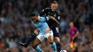 Rooney on target again as Man City struggle at home
