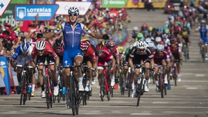 Matteo Trentin celebrates as he crosses to win Stage 4 of the Vuelta a Espana