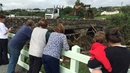 People watching the clean-up operation at Cockhill Bridge, Buncrana in Co Donegal