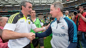 Jim Gavin (r) congratulates Jim McGuinness after his Dublin lose to Donegal in the 2014 semi-final
