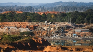 An open air tin mine in a deforested section of the Amazon