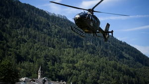 A helicopter is seen over Bondo after the landslide