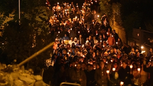 Residents held a silent candlelit march, which wound its way through streets of the devastated town