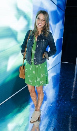 Amy Huberman stunned in a floral green dress by Reformation under a denim jacket by Anthropologie. She finished the look with a pair of tan boots from Bourbon.