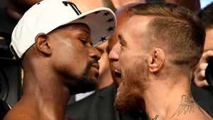 Floyd Mayweather (L) and Conor McGregor at the weigh-in
