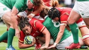 Sioned Harries burrows over for a Welsh try
